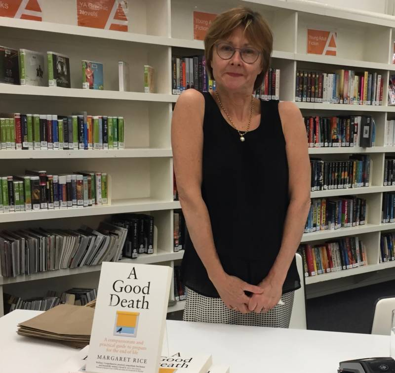 Elizabeth Phillips of Woollahra Bookshop at Paddington Library with the book A Good Death by Margaret Rice.