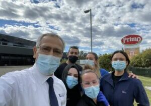 Dr Jamal Rifi with his team vaccinating Primo workers